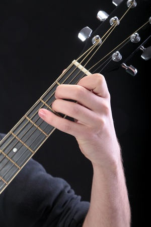 e guitar: Human hand taking  E-major accord at guitar Stock Photo
