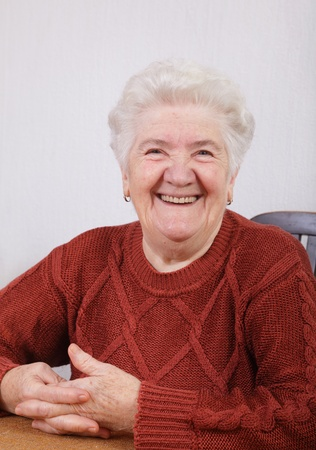 Portrait of  smiling senior woman in her room Stock Photo - 8664563