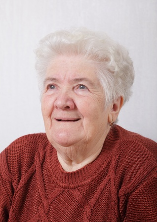 Portrait of serious senior woman in her room Stock Photo - 8664566