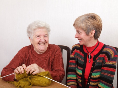 knitting needles: Senior and mature womans speaking  and laughing Stock Photo