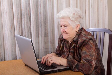 Portrait of a senior woman working at computer Stock Photo - 8719578