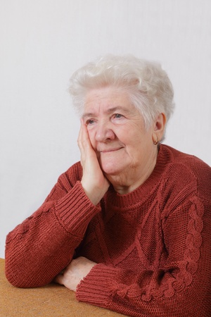 Portrait of worried senior woman in her room Stock Photo - 8808151