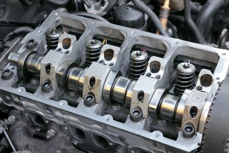 engine parts: Repairing of modern diesel engine closeup of camshaft and valves