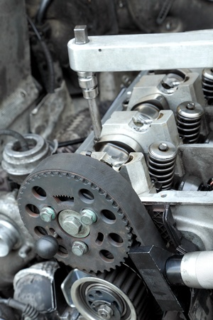 Belt, gear,  springs and camshaft of  car engine with socket wrench Stock Photo - 9116494
