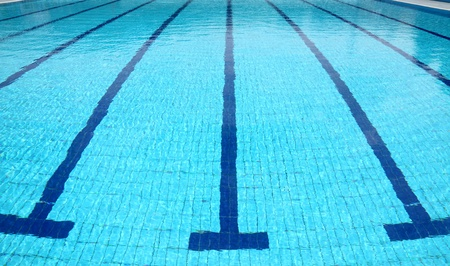 Detail from open air olympic swimming pool, water and lines photo