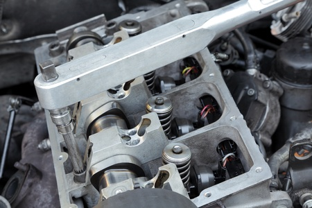 Belt, gear,  springs and camshaft of  car engine with socket wrench Stock Photo - 9116493