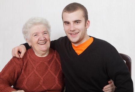 grandmother and grandson: Senior  woman and grandson laughing and hugging