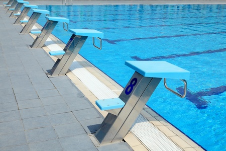 start fresh: Detail from open air sports competition swimming pool - starting places