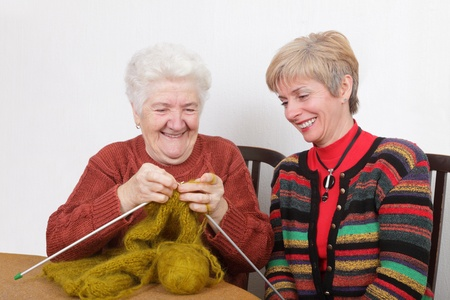 Senior and mature womans speaking  laughing  and learning knitting Stock Photo - 9225267