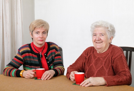 Senior and mature womans drinking caffee and smiling photo