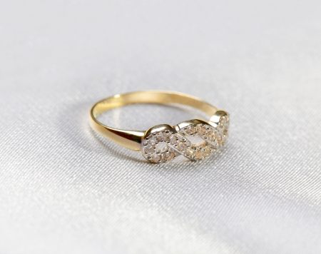 a golden  ring at white textile background photo