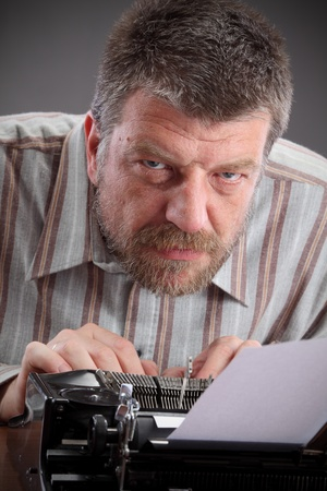 Middle age writer or journalist with typewriter