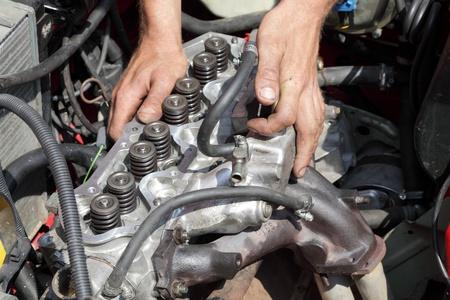 benzin: Repairing of modern gasoline engine, workers hands and engine head