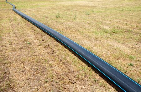 pvc: Plastic tube for water supply at meadow Stock Photo