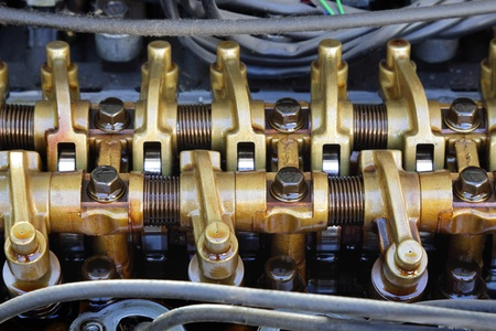motor vehicle: Close up of parts in engine head three valve per cylinder  system