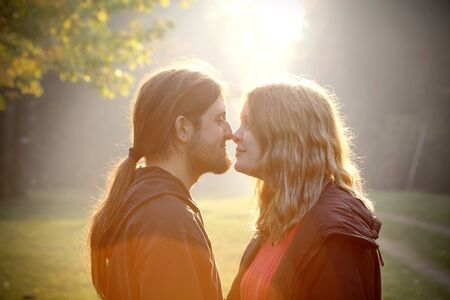 Young couple in foggy autumn morning photo