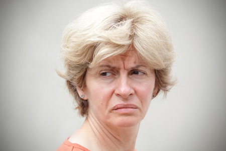 Portrait of mid adult woman in bad mood photo