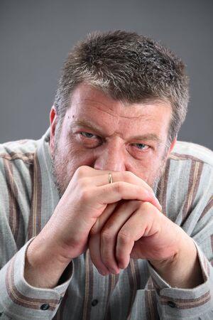 Portrait of mature Caucasian man looking to camera photo