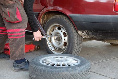 auto repair shop: Mechanic working on a car tire in service