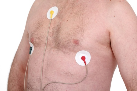 Caucasian Man Wearing Holter Monitor for heart activity photo