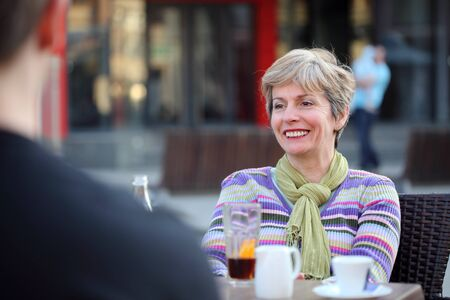 Smiling adult woman in cafe, selective focus Stock Photo - 12989300