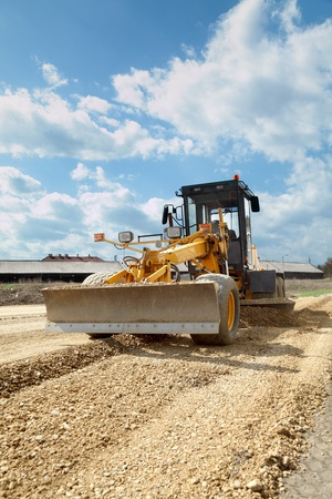 Grader working at road construction site photo
