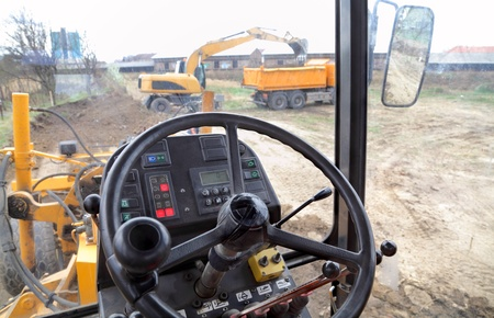 grader: Cabine of a grader at construction site Stock Photo