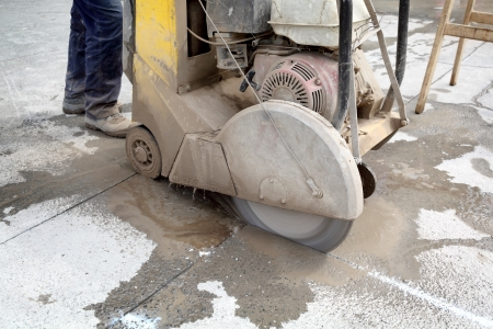 Asphalt or concrete cutting with saw blade Reklamní fotografie - 20925086