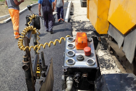 Control panel of asphalt spreader at construction site photo