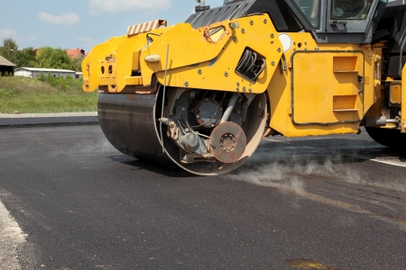 roller compactor: Road roller  at a road construction site Editorial