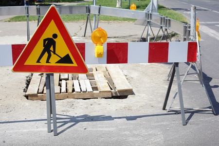 roadwork: Road signs in a street under reconstruction Stock Photo