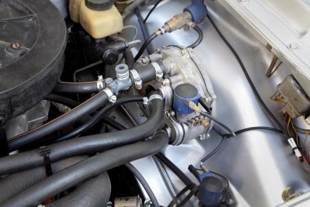 lpg:  LPG converted  car engine, closeup of regulator and evaporator Stock Photo
