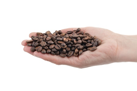 Close up of roasted coffee beans in human hand isolated on white Stock Photo - 14078366
