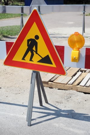 Road signs in a street under reconstruction photo