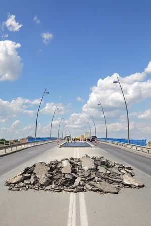 Damaged asphalt road and bridge in reconstruction, Novi Sad Serbia photo