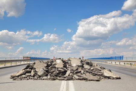 Damaged asphalt road and bridge in reconstruction photo