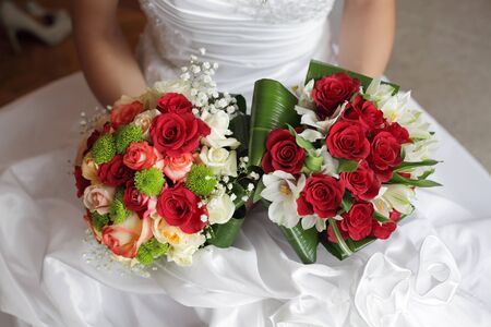 bridal bouquet: Bride holding two beautiful bouquet in a wedding day