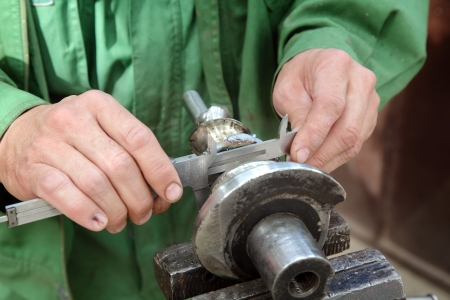 Close up of steel helicoid shaft measuring with caliper Stock Photo