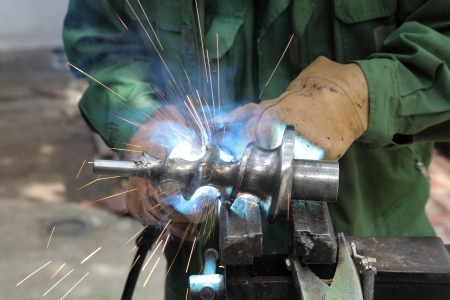 Closeup photo of arc welding of a steel shaft with helicoid Stock Photo - 15605821