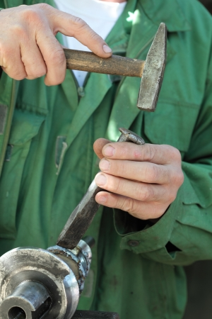 Welding slag removing with hammer and cutter after welding Stock Photo - 15605811