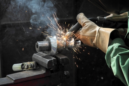 Closeup photo of arc welding of a steel shaft with helicoid Stock Photo - 15605802
