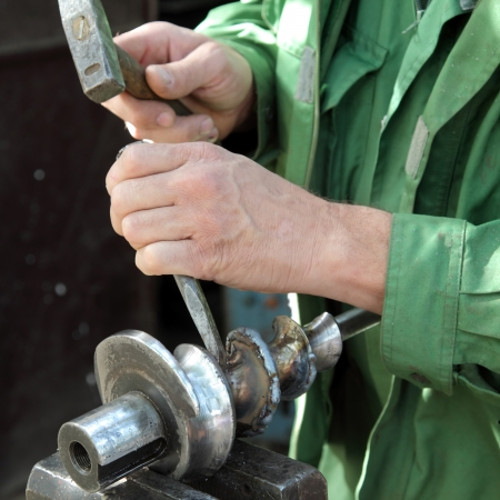 Welding slag removing with hammer and cutter after welding Stock Photo - 15605810