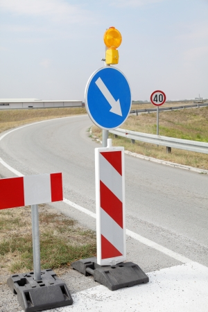 Road signs in a highway on reconstruction photo