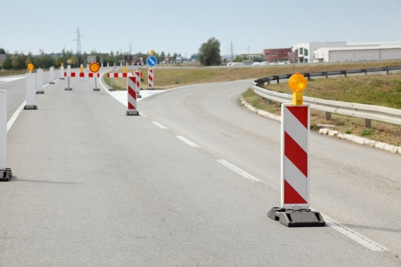 traffic cone: Roadworks, road signs in a highway on reconstruction Stock Photo