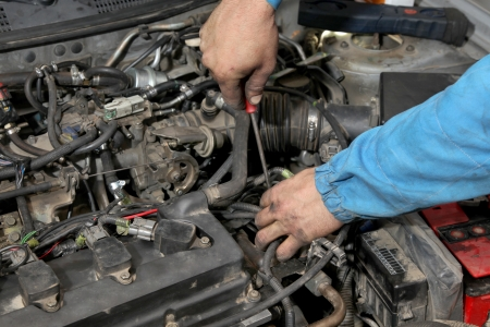 servicing: Servicing of modern car gasoline engine, workers hands and tool