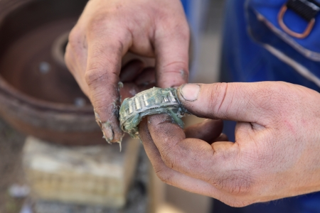 lubricate: Mechanic lubricate a roller bearing with lithium grease