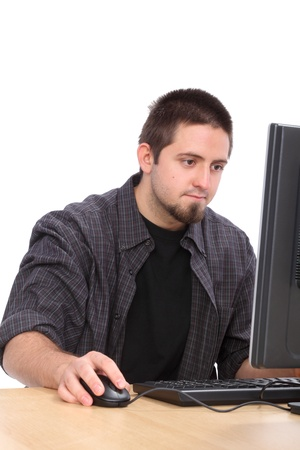 Education, young cheerful Caucasian student and his computer Stock Photo