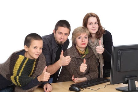 Education, Caucasian students and teacher with thumbs up and computer photo