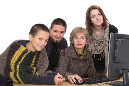 Education, smiling Caucasian students and teacher with computer photo