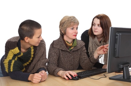 Education, Cheerful Caucasian students and teacher with computer photo